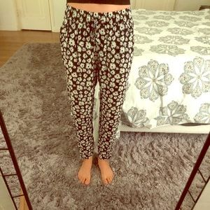 Black pants with white flowers